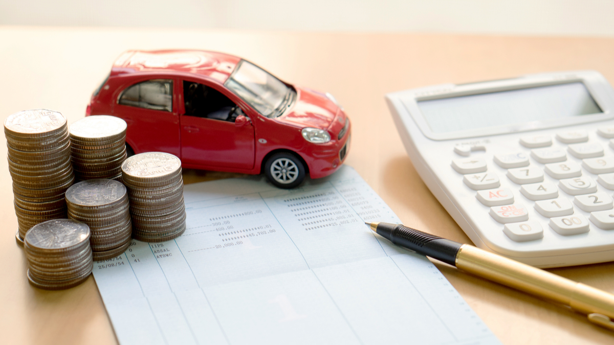 Photo illustration of coins, calculator, toy car