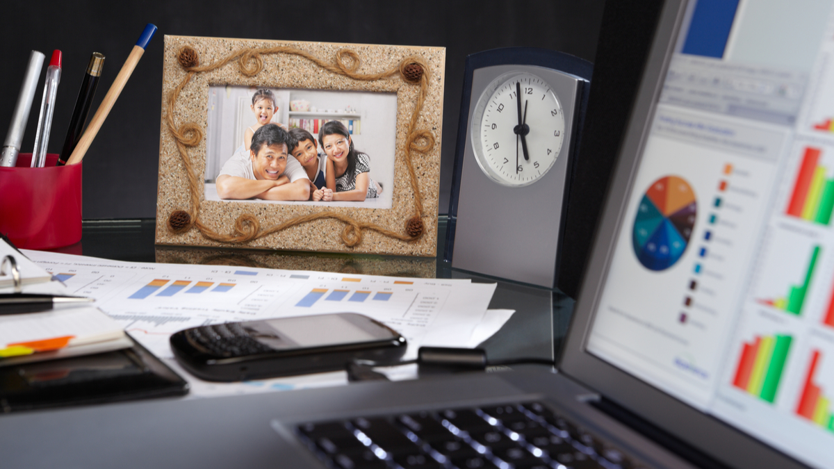 family photo on desk with laptop