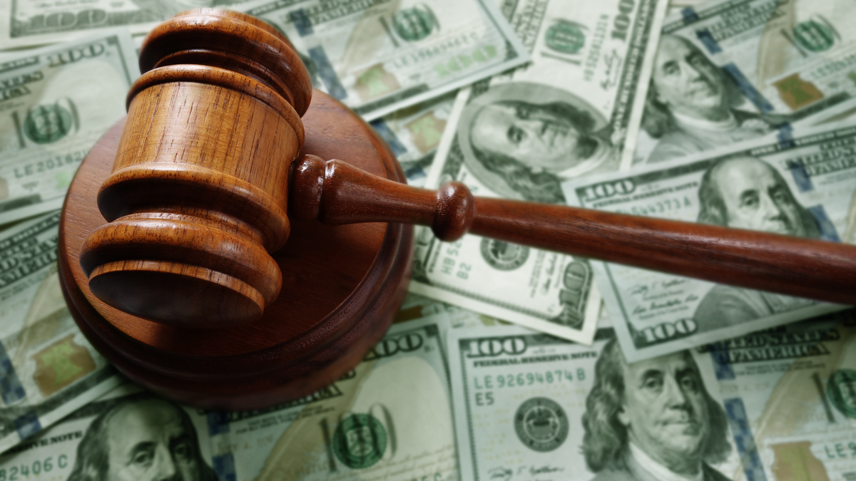 Photo illustration of judge's gavel and cash