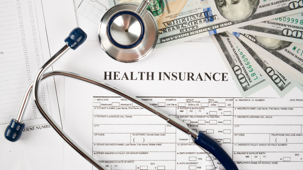 Photo illustration of insurance form and stethoscope