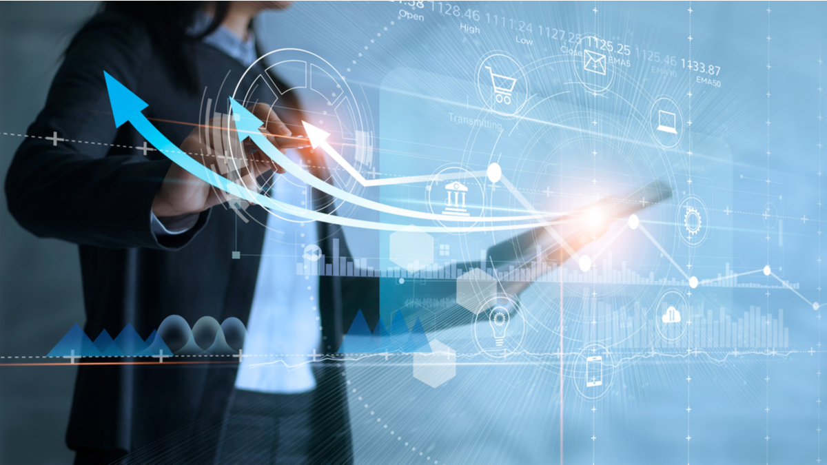 Photo illustration of business woman and charts