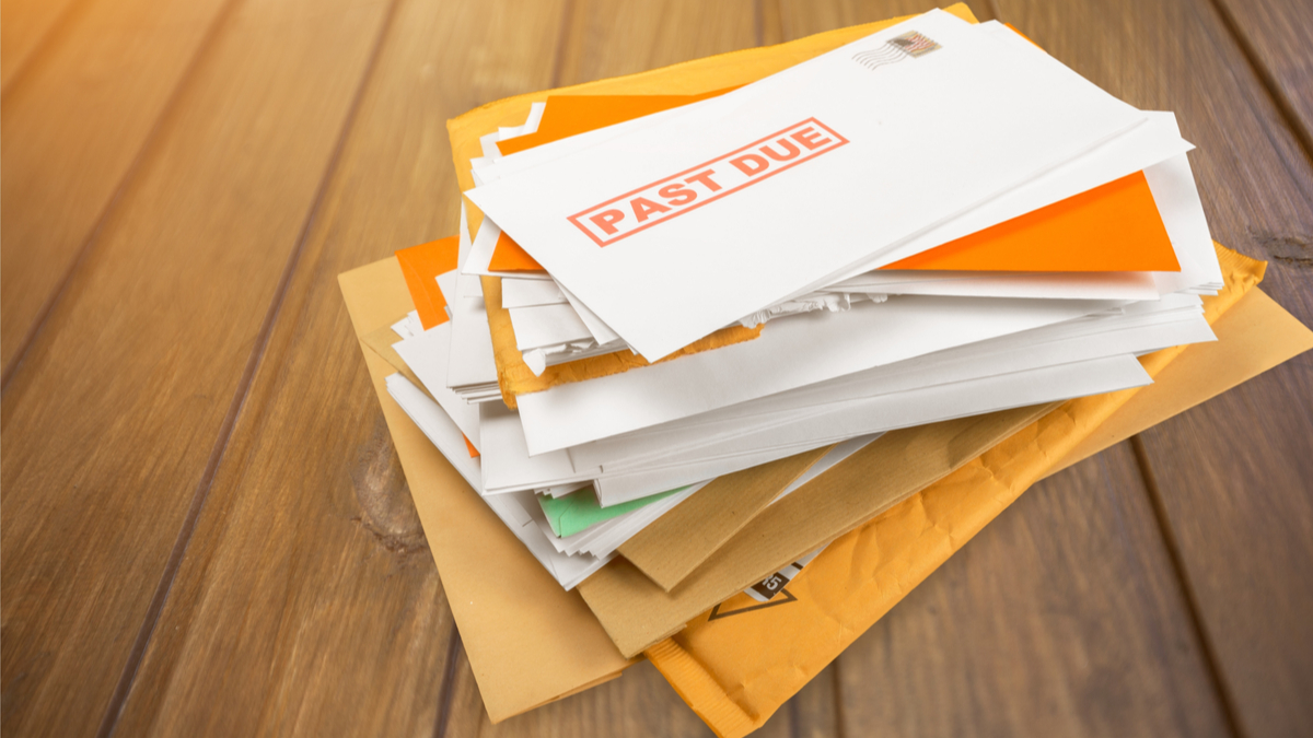 Photo of pile of past-due bills