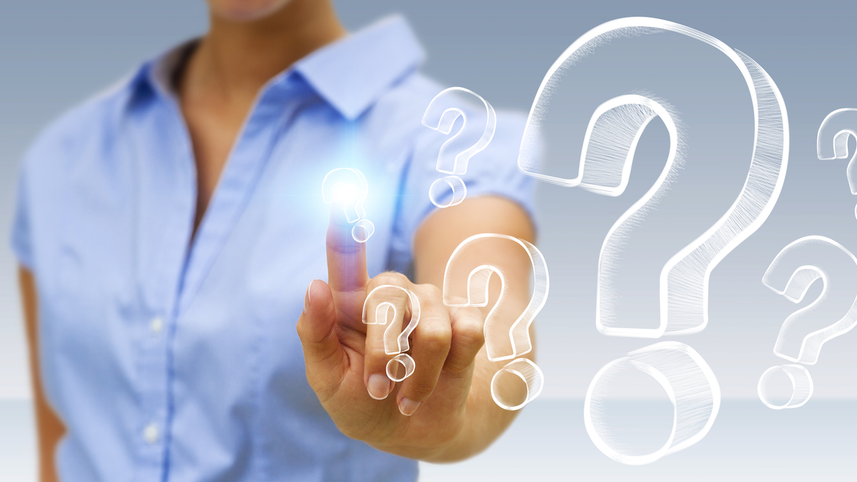 Photo illustration of business woman and question marks