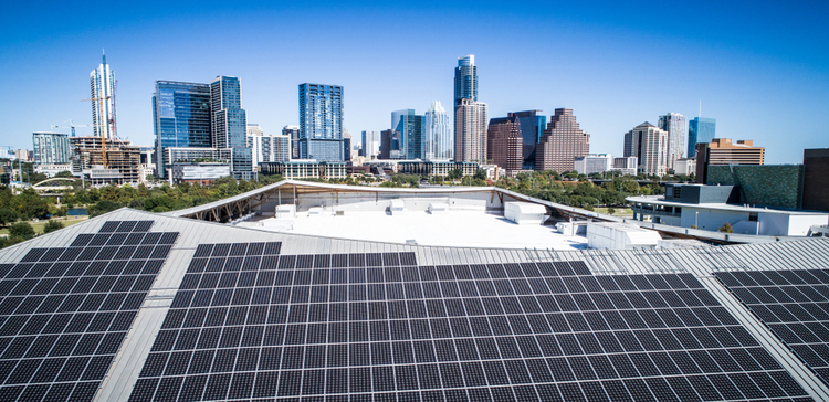 Photo of Austin, Texas, skyline framed by solar array