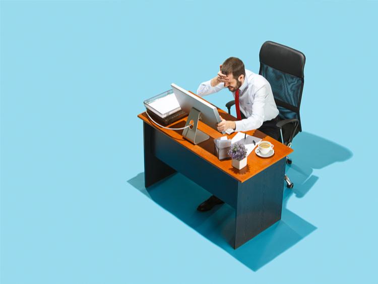 Stressed business man at desk