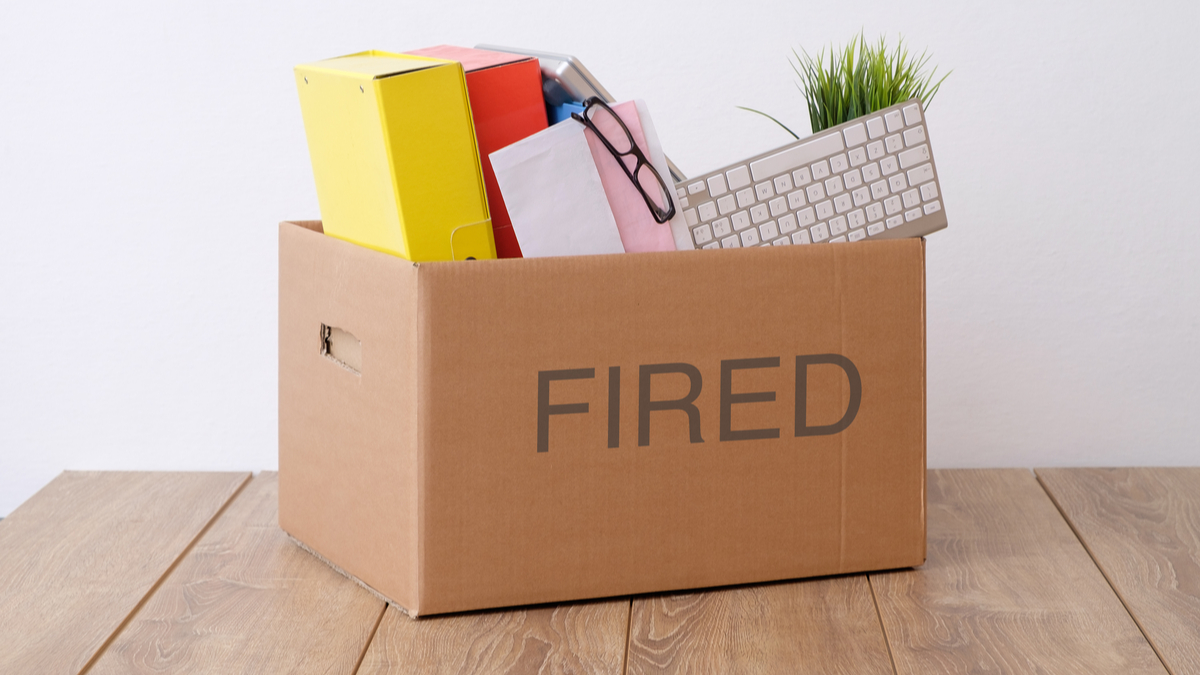 "Box of personal belongings labeled ""Fired"""