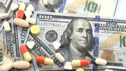Photo illustration of drugs and money