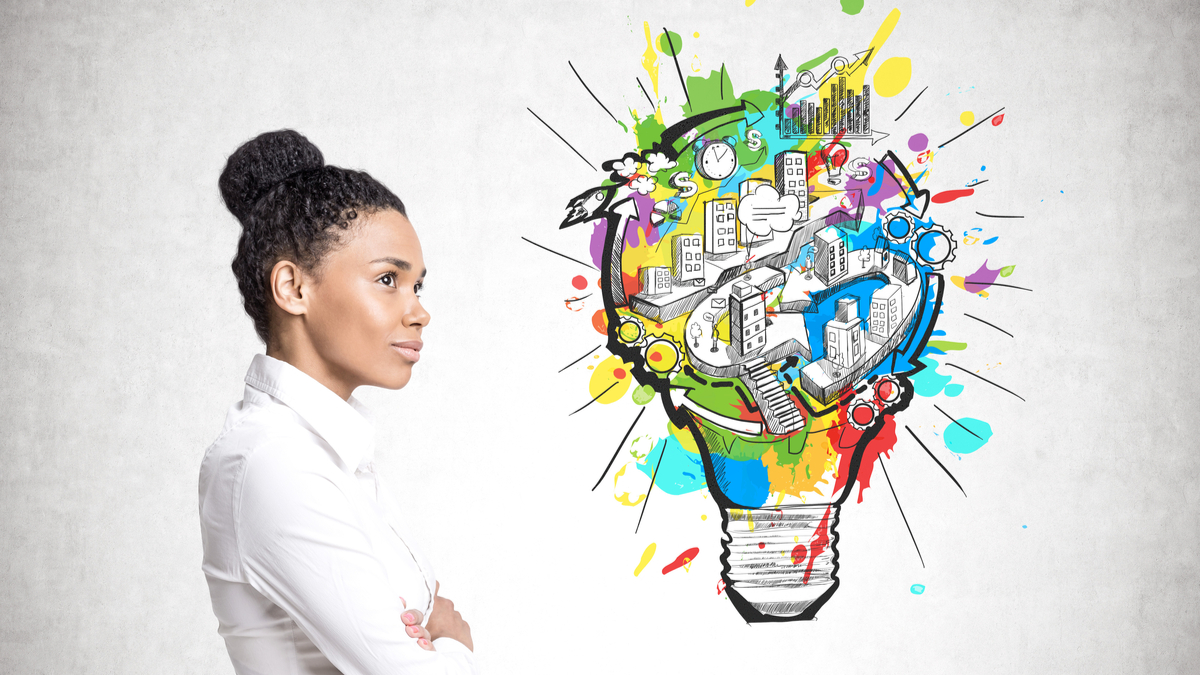 Photo illustration of professional woman thinking with light bulb