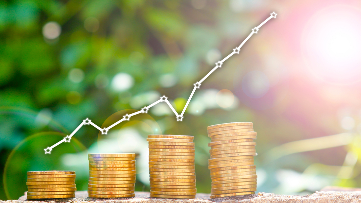 Photo illustration with stacks of coins and a business graph