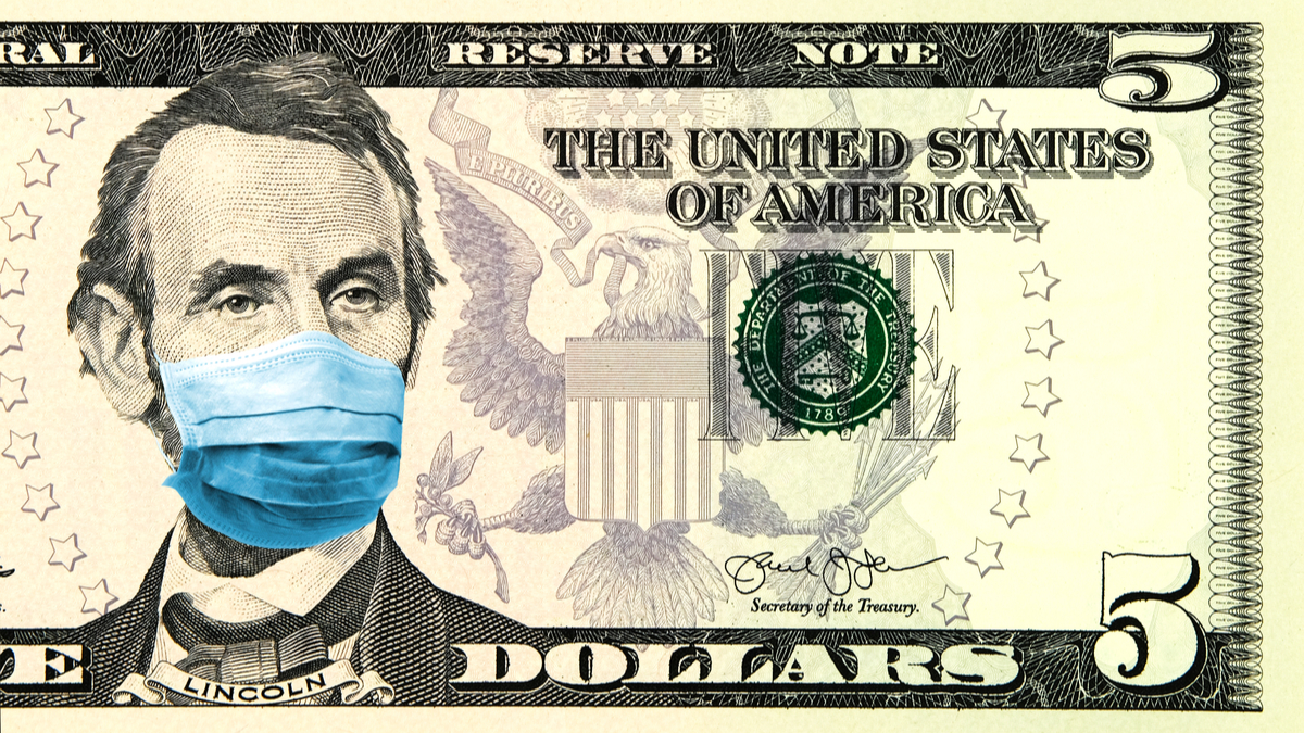 Photo illustration of $5 bill with Lincoln wearing a medical mask