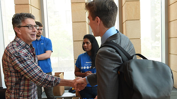 Fintech Conference student shaking hands