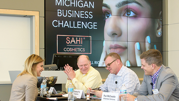 Michigan Business Challenge students interacting