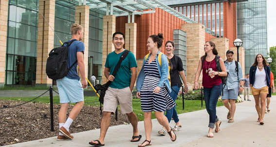Students walking ouside of the Ross building
