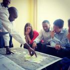 Sustainable Harvest MAP team members meet government officials in Kibeho, Rwanda, to discuss economic development.