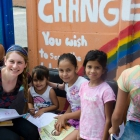 Undergraduate Danielle Flanders reads to children in the Nicaraguan refugee village of La Carpio, Costa Rica.