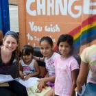 Undergraduate Danielle Flanders reads to children in the Nicaraguan refugee village of La Carpio, Costa Rica.