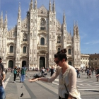 Megan Vitale makes a new friend while visiting the famous Duomo of Milan.