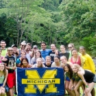 Costa Rica course: Students show their Michigan pride while trekking through the rainforest.