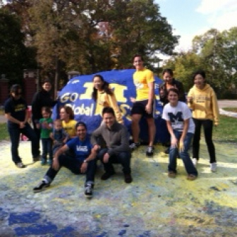 "Ross exchange students participate in the University of Michigan student tradition of painting ""The Rock."""