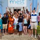 Professor Jim Walsh and his students making new friends at a business school in Accra, Ghana.