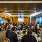 During the event, guests enjoyed dinner and watched Michigan face off against Oregon in the Sweet 16.