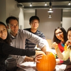 Ross exchange students participate in the American tradition of carving pumpkins.