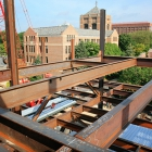 The steel structure of the new Jeff T. Blau Hall, facing the University of Michigan Law School and Lorch Hall.