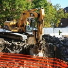 Demolition continues as concrete debris is removed from the construction site in October 2014. The debris was recycled as part of Michigan Ross' sustainability efforts.