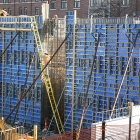 This blue framework, which is waterproof and insulated, will hold the distinctive terracotta finishings on the east wall of the renovated Kresge Hall.