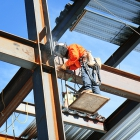 A steel welder at work on Jeff T. Blau Hall in July 2015.